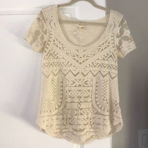 Cream colored short sleeve lace top